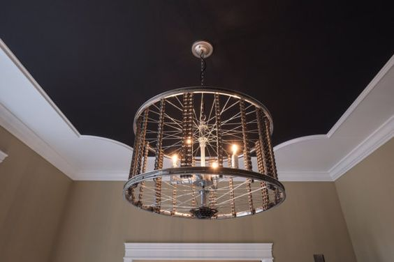 This chandelier is made from repurposed bicycle rims and chains. A perfect chandelier for a foyer or dining room. It has a great modern and