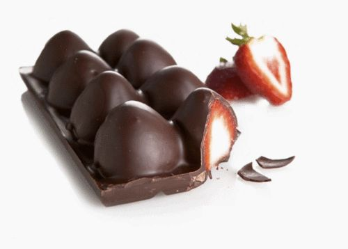 Fill an ice tray with melted chocolate and put strawberries in them and the freeze them...What a duh idea! :)