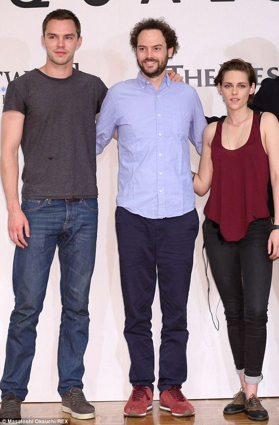 Sci-fi: Kristen posed alongside co-star Nicholas Hoult (far left) and director Drake Dorem...