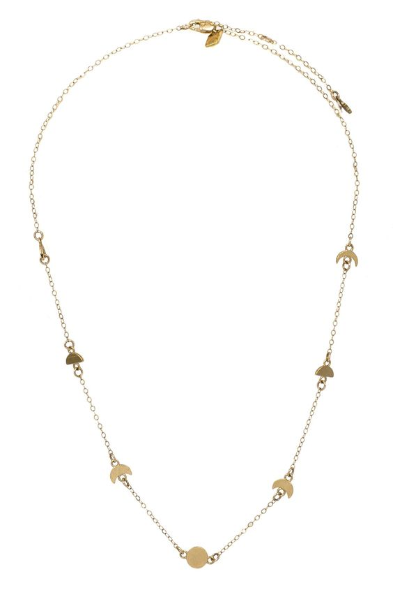 "The Ara Moon Phase Choker is celestial-inspired piece with a touch of geometric styling. The combination of magical influence and short length make this necklace a definite eye-catcher.Measures 15.75"" in length with a 2"" extender.Gold fill chain with gold plated Sterling Silver pendants or Sterli..."