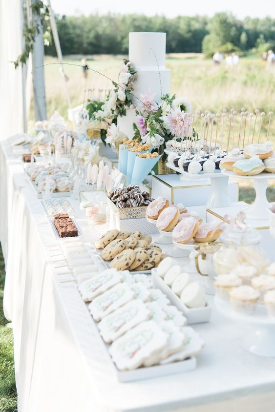 A Gorgeous Backyard Wedding in Buffalo, New York | Brides | Planning: KC You There | Photo: Bridget Rochelle Photography | Florals: Bows & Arrows Flowers | Dessert bar: B Sweet Designs - Click to see more of this beautiful outdoor wedding! Incredible Sweets Station #summerwedding #nywedding #outdoorwedding #luxurywedding #weddingcake #weddingdesserts #dessertbar