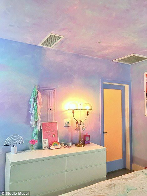 Her walls are pastel watercolors with a cave mural above her bed, and she has fun pops of light and rainbows throughout