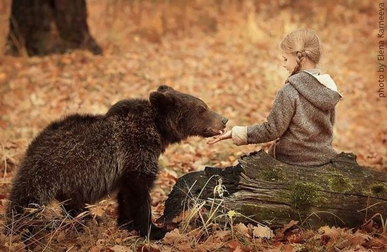 Russian photographer.  Child and animal