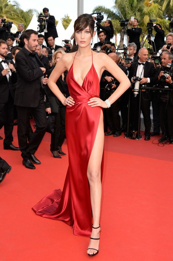 Bella Hadid in a thigh-high-slit custom Alexandre Vauthier gown and Giuseppe Zanotti heels on The Unknown Girl's red carpet.