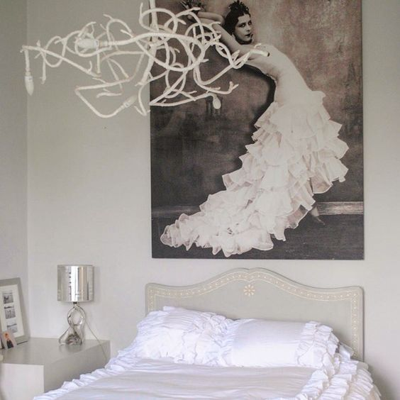 This white bedroom  anyone know who the lady in the painting is? I have no idea and it's haunting me! #housetours #livingetc #livingetchousetours #white #bedroomideas #instabedroom #lbloggers #homeideas #interiorstyling #lifestyleblog #decorations #allwhitescene