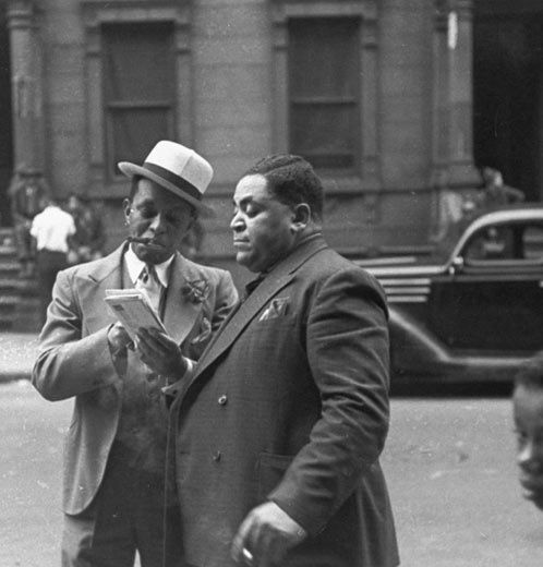 Jazz musicians Willie 'The Lion' Smith and Fats Waller look at letters in their hometown of Harlem, New York in May 1937 by Charles Peterson ""