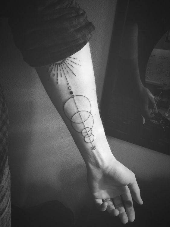 Abstract solar system tattoo. Alleged Tattoo, Seattle, WA.