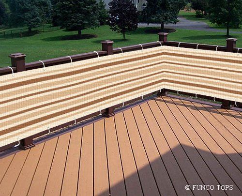 This striped cover attaches easily to any kind of fence or even deck railing like this one. It's also striped to provide a little bit of decor to the porch or yard.
