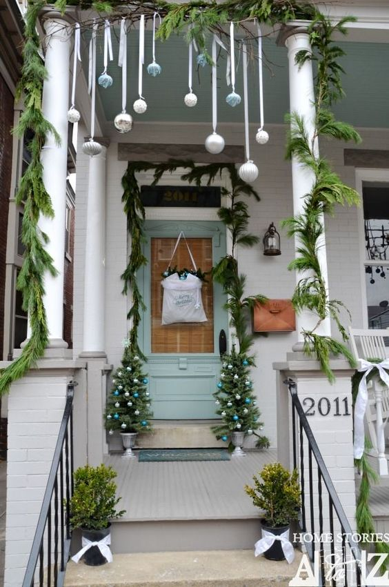 Christmas porch tour. I like the blue color on the door