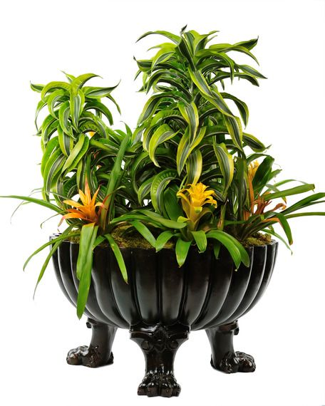 Get the Look: Collections Inspired by LCDQ's Storytelling by Design- This dramatic claw foot planter by Dragonette Ltd. is cast from an original 19th century terra cotta planter. The new castings are done in acrylic polymer resin and hand colored in a bronze finish. Though large in scale they are light weight. Finishes can be customized. Dragonette Ltd.