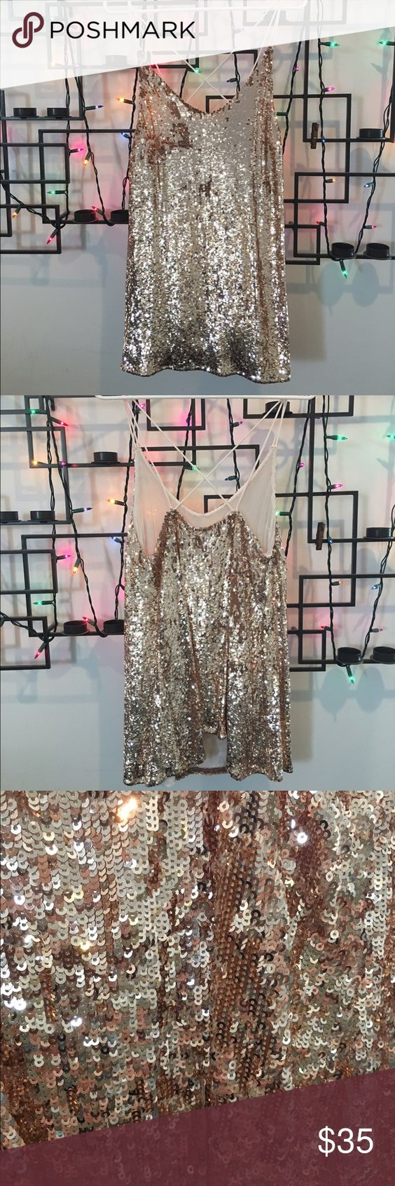 Free People Sequin Dress/Tunic This is a Free people sequin dress/tunic depending how tall you are. It's like a champagne color sequin with a skinny strap that crosses in the back. It's only been once and is in great condition! Free People Dresses Mini