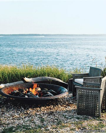 I'd use real logs, but I like the idea of this fire pit.  It looks like of like a bigger version of the one I've got now.
