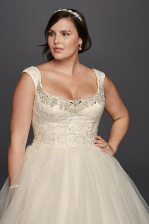 Make a statement in this simple yet elegant tulle ball gown. Featuring a structured bodice and full skirt, this radiant gown includes a beaded lace, scoop neckline with tip of the shoulder cap sleeves, scoop back buttons and chapel train. Wear this wedding dress and it'll surely be one to remember!  Oleg Cassini, exclusively at David's Bridal.  Also available in Regular, Petite, Extra Length and Plus Size Extra Length. Check your local stores for availability.  Chapel train. Fully lined.: Full Skirts, Wedding Dressses, Lace Wedding Dresses, Chapel Train, Beaded Wedding Dresses, Cap Sleeves, Gown Includes, Gown Featuring