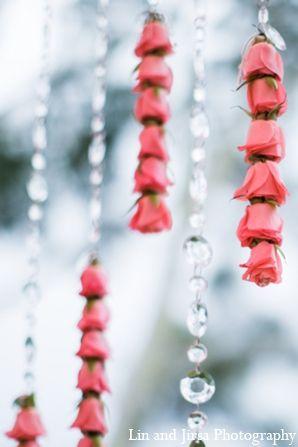 The outdoor Hindu wedding ceremony took place under a glorious light pink mandap.