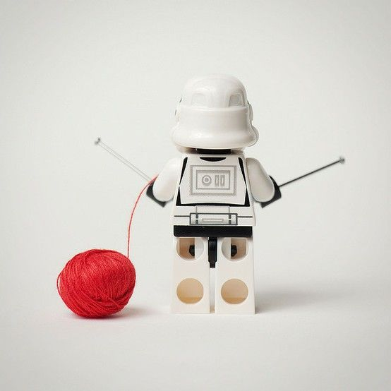 Robot is knitting with red yarn :)
