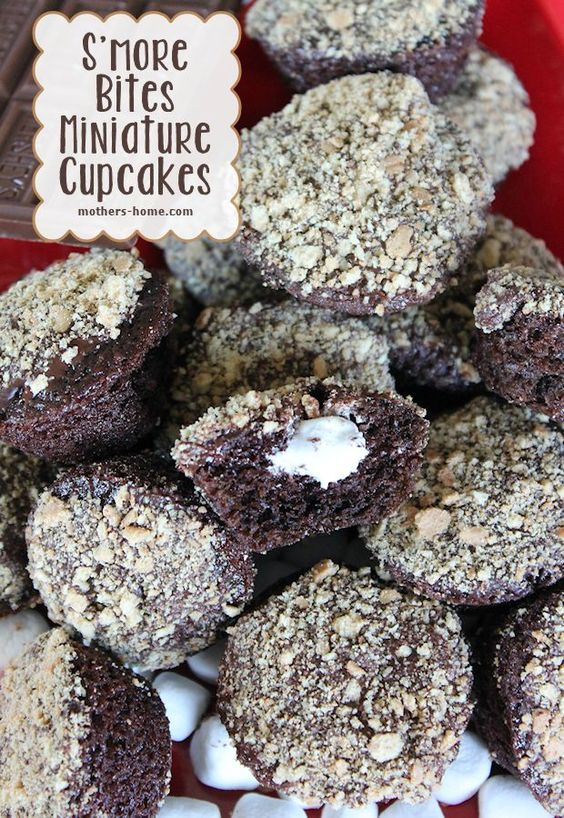 S'more Bites Mini-Cupcakes Recipe | Mother's Home        MUST make these.  Chocolate mini-cakes filled with marshmallow cream, dipped in chocolate ganache and sprinkled with graham cracker crumbs.  Post has recipes to make the cakes and cream from scratch, too!
