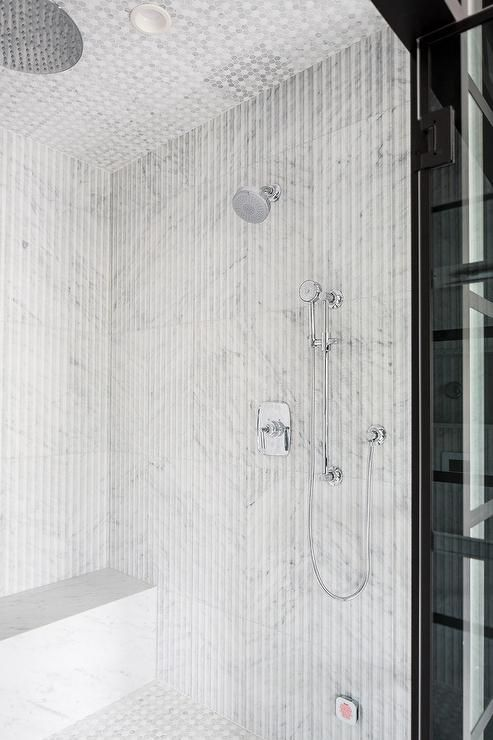 Large Walk In Shower Is Clad In Vertical White And Gray Stripe