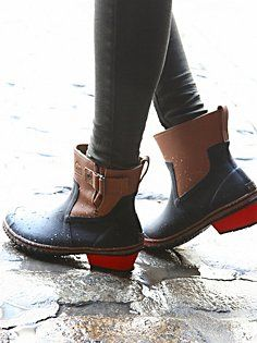 Watch out puddles! These red-heeled ankle Rain Boots are all about ...