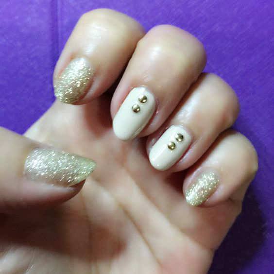 Glitter nails with gold studs on accent nails nailart