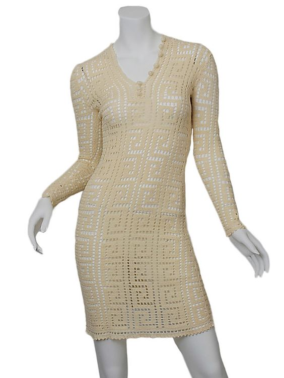 Beautiful Ivory crochet dress. Long sleeves. Slips over head. Body-conscious fit. Era 1970s. Excellent vintage condition. Measurements are taken flat (not on body).   Bust 28″  Waist 24″  Hips 30″  Shoulder 15″  Sleeve Length 24″  Length 35″  Material Cotton  Estimated Size XS