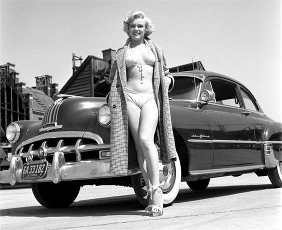 Marilyn Monroe stands along side a 1950 Pontiac