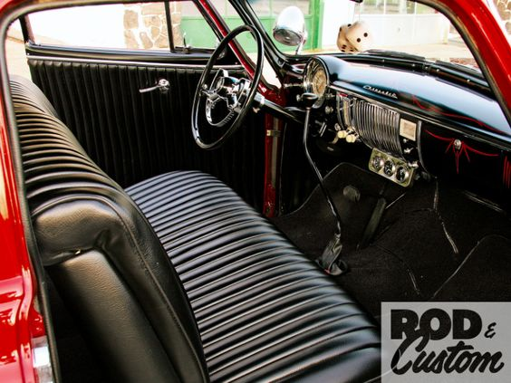 Black naugahyde, rolls and pleats.  Reminds me of my '56 Chevy.