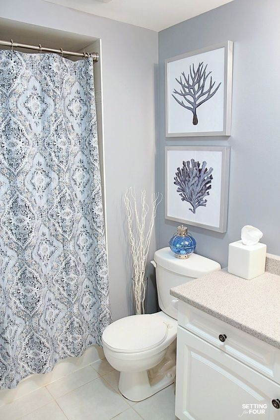 DIY - How to Hang Pictures Tutorial. See the measurement rules for hanging art at the proper height above a toilet. I'm sharing my secret picture hanging trick that works every time and check out my mini bathroom makeover!