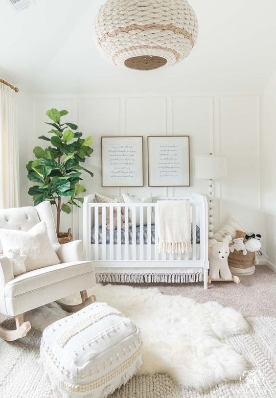 White boho nursery design for girl and boy babies, gender neutral nursery, fiddle leaf fig tree, white crib, rattan elements, weaved light pendant. #bohonursery #neutralnursery
