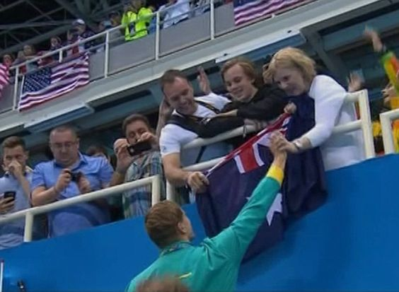Greeting an Olympic gold medallist, Chalmers holds his proud mother Jodie's…