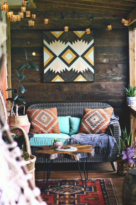 The Boho Porch Makeover at bohocollective.com // bohemian home decor, boho porch, bungalow, jungalow style, world market, earthbound trading, dream porch, screened in porch, barn wood project, boho rug