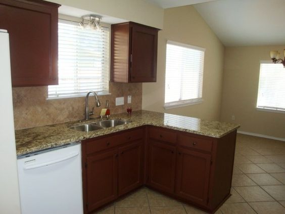 Kitchen  features granite tops, new deep under mount sink, new faucet, new tile backsplash.(4/2014)