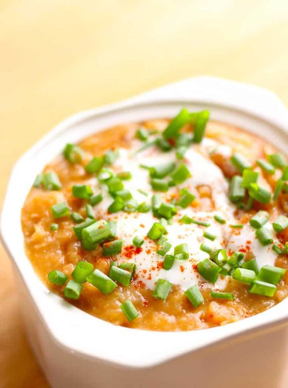 Mayocoba Bean Soup, a hearty Peruvian soup. This is also known as Canary Bean Soup with parsnips, onions, garlic and smoked paprika. Garnish with sour cream, scallions and smokey bacon.