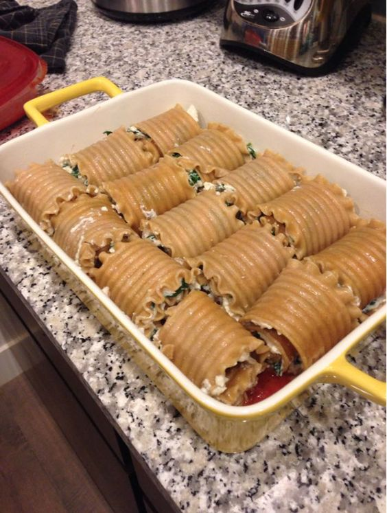 Made these last week and the are DELICIOUS!! If you are doing the 21 day fix its one yellow, one green, one red! Ingredients9 lasagna noodles, cooked1 (10 ounce) package frozen chopped spi...