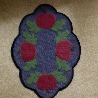 This was a fabric place mat ,I liked it so much I made a 100 per sent wool Table mat .