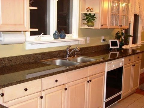 Customer In Concord NC Gives Testimonial For Fireplace And Granite  Distributors Who Installed Tropic Brown Granite Countertops In Their Home.