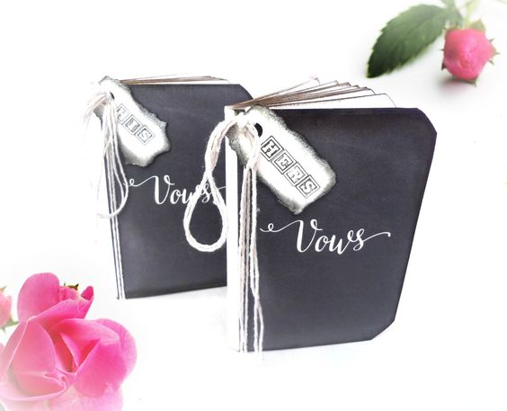 This rustic style wedding vows books or vows renewal books are handmade from scratch. The covers are featuring the word Vows in a beautiful calligraphy script on a chalkboard style background, and are