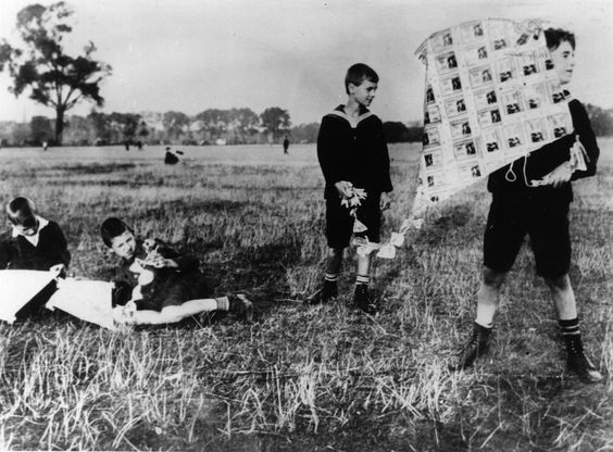Money kite. A boy with a kite made of banknotes in Germany, when escalating inflation rendered currency worthless.