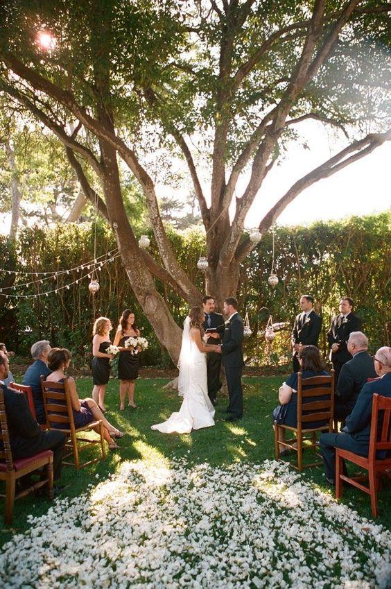 budget backyard wedding ceremony decorations minimalist white petals aisle