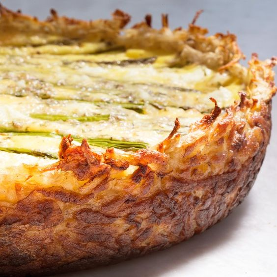 Get all the goodness of hash browns and a rich Fontina and goat cheese egg custard in this unexpected quiche. With fresh green asparagus and tarragon, it's perfect for a springtime brunch, lunch, or light dinner.