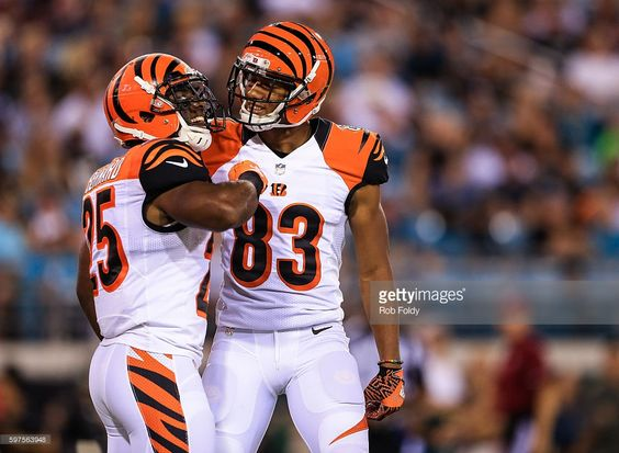Giovani Bernard #25 of the Cincinnati Bengals celebrates with Tyler Boyd #83 after rushing for a touchdown during the first quarter of the preseason game against the Jacksonville Jaguars at EverBank Field on August 28, 2016 in Jacksonville, Florida.
