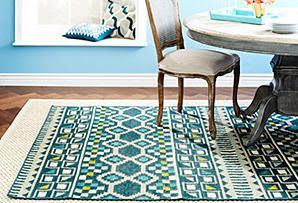 I love the layered look of these rugs... you get the area you need without it being too bold (or too expensive!)