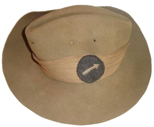 The Slouch Hat, this example WW2, with the 'golden arrow' formation sign of the 7th Indian Division (14th Army.)