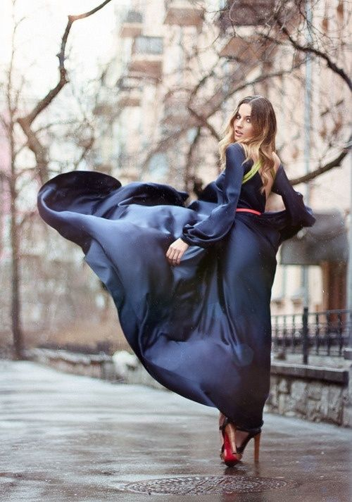 Navy silk dress in the wind