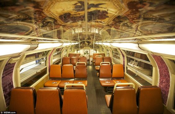 Powerful imagery: The train carries the colours of the Palace of Versailles, which was once the centre of political power in France