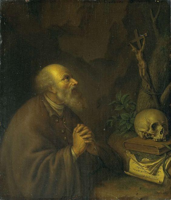 Frans van Mieris (II) | The Hermit, Frans van Mieris (II), 1721 | Een kluizenaar met gevouwen handen geknield in een rotsachtige omgeving voor een kruisbeeld, schedel, boeken en een papier met Hebreeuws schrift.