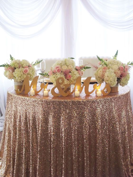 Fabulous pink sequin table linens with gold Mr. & Mrs. letters. Flowers, decor and rentals by Posh Peony Floral and Event Design.