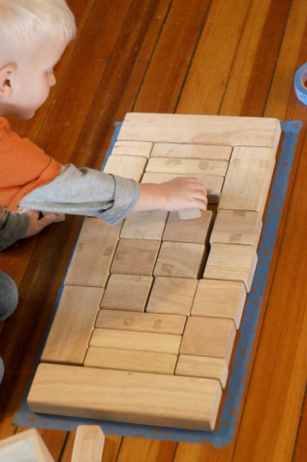 Great problem solving challenge! Fill in the tape shape with blocks.: