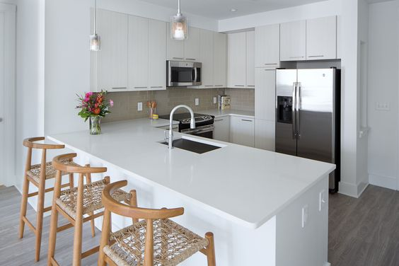 Wood chairs can be the first step to bringing life to a kitchen dressed in neutral whites and grays.