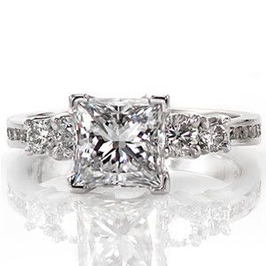 Five stone princess cut diamond engagement ring with channel set diamond embellishments.  Princess Belle from Knox Jewelers
