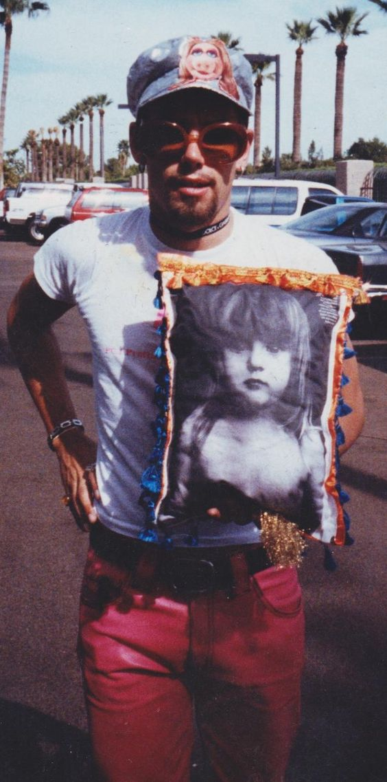 Me in Phoenix in the 90s w/a pillow I handmade for @Courtney Love. I also have a shirt she signed that i was wearing. Was told it was the only item she carried off the bus at the next stop, Los Angeles. Maybe now I'll find out. : )